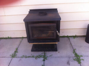 Wood burning stove c/w chimney piping