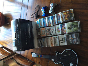PS3 console, 2 controllerrs, 1 guitar hero, 20 games,move camera