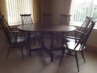 Ercol Oval drop leaf Dining Room Table with 6 Ercol Chairs