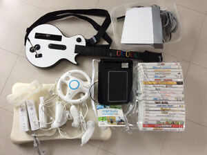 · WIi console, 22 games, Fit Board, 3 controllers, 4 nunchucks,