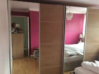 Two mirrored double wardrobes in excellent condition