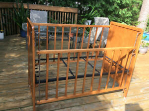 Solid wood toddler crib with mattress