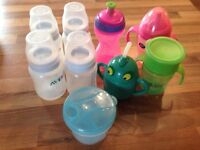 4 avent bottles and 4 drinking cups and bottles