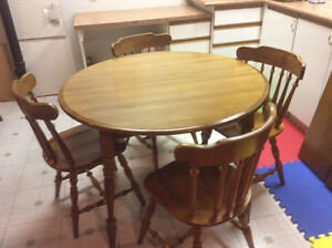 Solid maple extendable table and four chairs $125.00