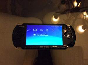 Excellent condition black PSP, charger, cases, games and moives