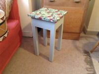 Side table ...flowery top and grey painted legs.