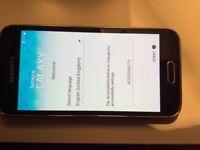 SAMSUNG S5 MINI BLACK/ON 02 PERFECT-COND!!!