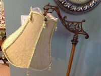 Antique brass pole lamp with tasseled shade