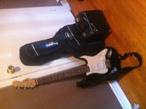 Selling my Squire Fender electric guitar w/ amp and case