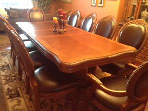 One of a kind, 10 seater dining room set with matching hutch