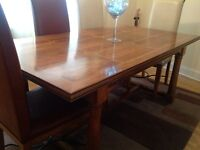 Matching Hardwood table with 6 chairs, sideboard & coffee table.