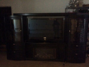 Black 11 foot wall unit, TV & Fireplace