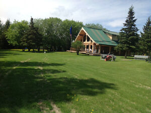 BEAUTIFUL, AFFORDABLE LOG HOME ON ACREAGE FOR SALE