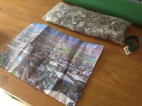 Puzzle role mat in a tube and 1000 piece puzzle. Brand New
