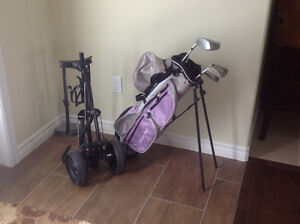 Youth golf clubs with caddy.