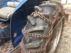 Reliable old diesel tractor with front bucket back blade