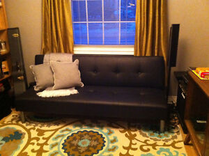 Black faux-leather futon for sale. Can deliver in St. John's!