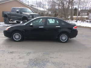 2009 Ford Focus SE sedan 5 speed ,cb,pw,cold air 160 kms $3250.0