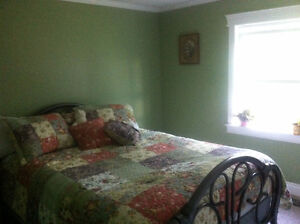 Bedroom with separate full bath in shared home