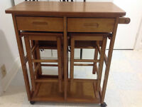 Winsome Space Saver on wheels, with 2 store away stools for sale