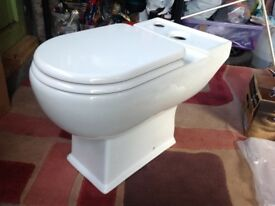 Brand new toilet with soft close toilet seat