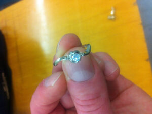 10kt white gold ring with two teeny diamonds and a gemstone