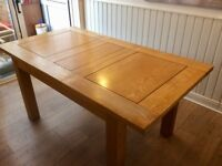 Solid oak extendable dining table (no chairs)