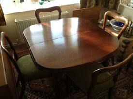Antique mahogany dining table plus four chairs - seats up to 8