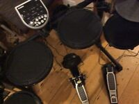 Alesis DM6 Electric Drum Kit in great condition.