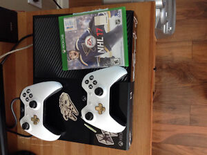 X box one with 2 new games more on console with 1 year Xbox live