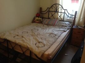 Double bed with mattress and bedside cabinet