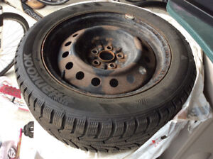 5x100- winter tires with rims used on a Toyota Matrix
