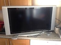 "32"" TV, Stand and Surround Sound System"