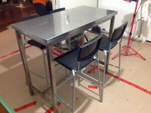 Stainless steel kitchen table and chairs.