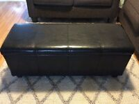 Black faux leather ottoman with storage