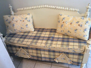 Antique spindle bed converted into a bench