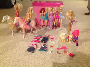 Barbies, carrying case and animals