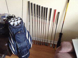 Golf clubs and bag plus cart and other golf stuff