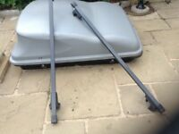Car top box with roof bars.