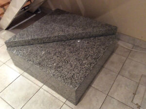A granite table that could be separated into two tables,