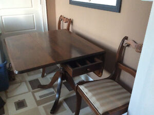 Beautiful Duncan Phyfe drop leaf table & 2 chairs just recovered