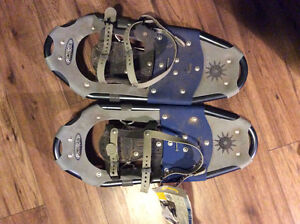 Tags still on  snow shoes