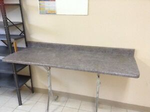 "A 66"" Formica kitchen counter with double stainless steel sink ."