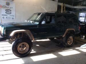 2000 Jeep , trade for 4 wheeler