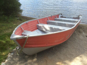 16 foot boat, deep and wide with 20hp Mercury (no tailer)