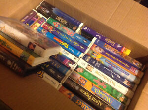 TV with built in VCR and 3 boxes of Disney VCR Movies