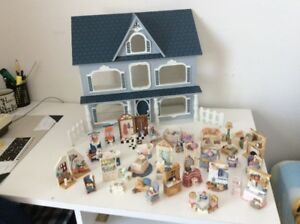 Doll House with furniture included. Excellent Condition.
