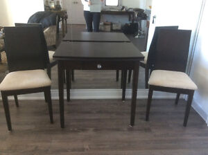 Lovely condo size dining table and two chairs