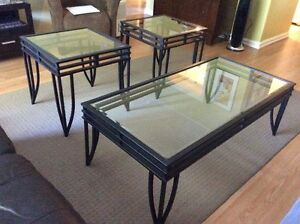 Glass-topped coffee table and two matching end tables