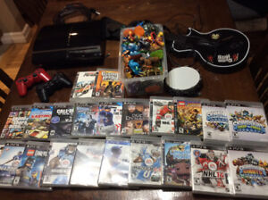PS3 plus skylanders, 2 remotes, lego dimensions, 18 other games